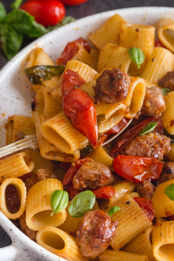 upclose sausage pasta in a white dish