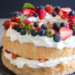 angel food cake with whipped cream and berries two layer cake