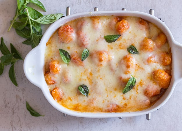 baked gnocchi double cheese tomato sauce in a white baking dish