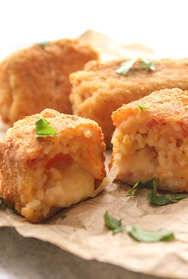 Suppli, Arancini, or Rice Balls an easy delicious Italian rice ball stuffed with mozzarella and fried. The perfect snack or appetizer. A must try.|anitalianinmykitchen.com