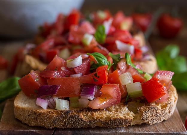 tomato bruschetta on toasted bread up close photo