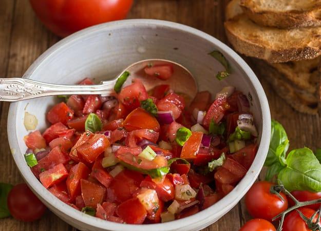 tomato bruschetta in a white bowl