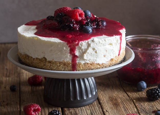 no bake berry cheesecake on a cake stand
