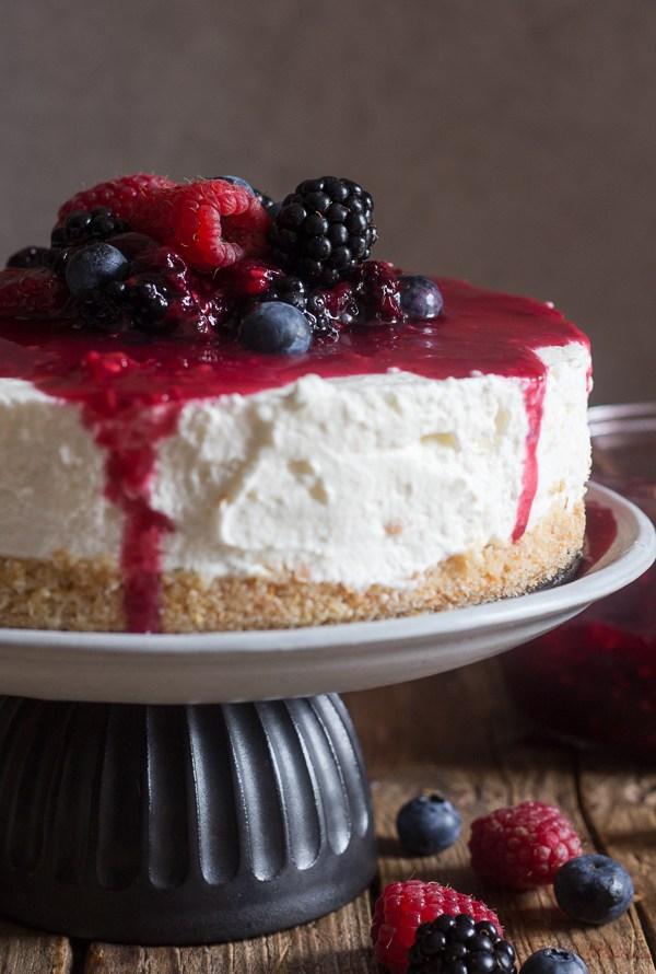 no bake cheesecake on a black & white cake stand