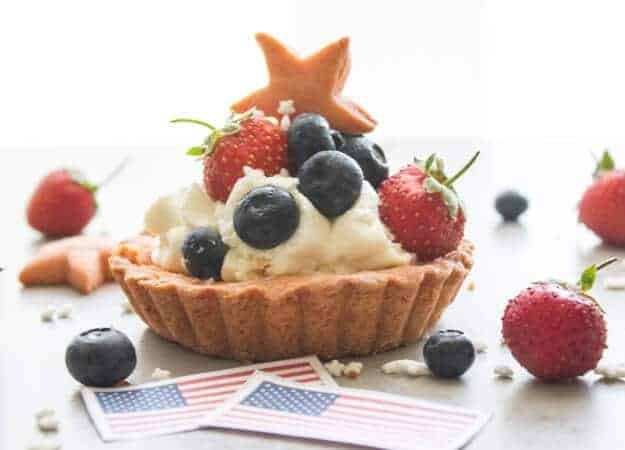 Creamy Filled Patriotic Fruit Tarts, a flaky pastry crust, filled with a creamy Mascarpone/cream cheese filling, an easy dessert recipe.