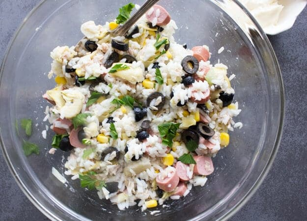 Mediterranean Rice Salad Bowl is a simple, fast cold Italian summer salad recipe. Full of veggies, tuna and fresh herbs. Healthy & Delicious.