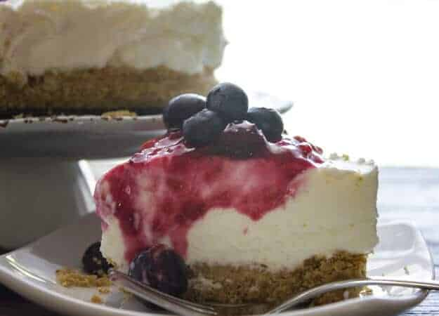 No Bake Summer Mixed Berry Cheesecake is the best, creamiest cheesecake the blueberry, raspberry filling makes it your new favorite.