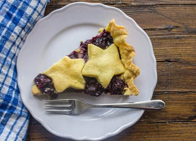 An Easy Italian Dessert Recipe, Blueberry Crostata made with a tasty fresh blueberry filling in a buttery flaky crust. Delicious.