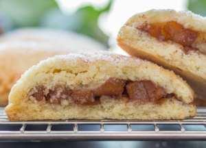 open apple pie cookies on a rack