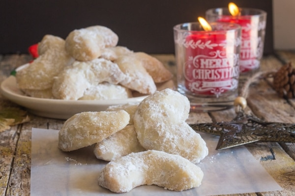 almond crescents on a plate and on white paper