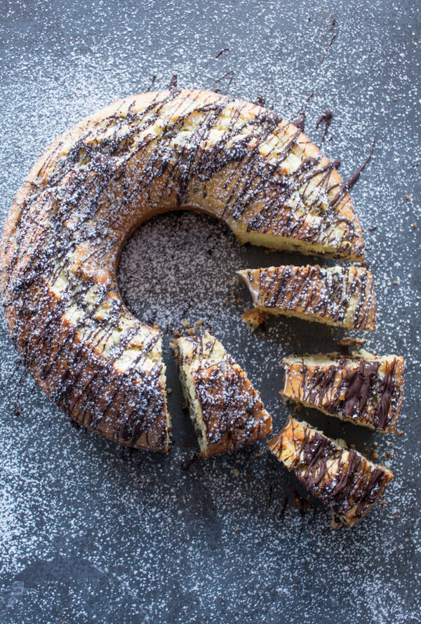 a top view of baked chocolate chip bundt cake with 4 slices cut