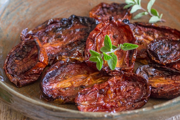 up close oven dried tomatoes in a brown dish