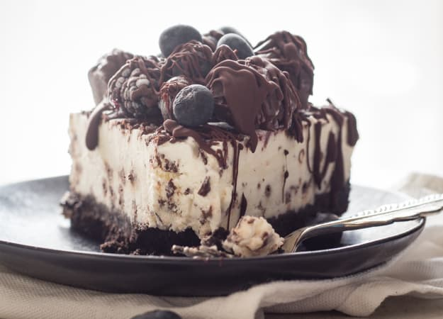 Light Cream Cheese Berry Cheesecake, a chocolate wafer base with a light cream cheese dark chocolate chip filling. a light and creamy no bake dessert.