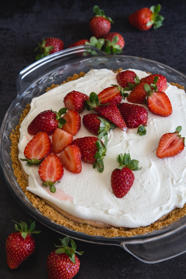 strawberry cheesecake in the pie plate on a black board