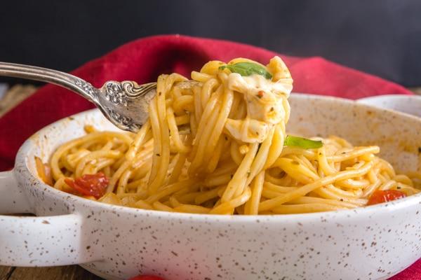 a fork of hot caprese pasta