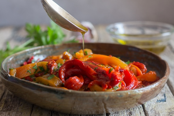 pouring olive oil on grilled peppers