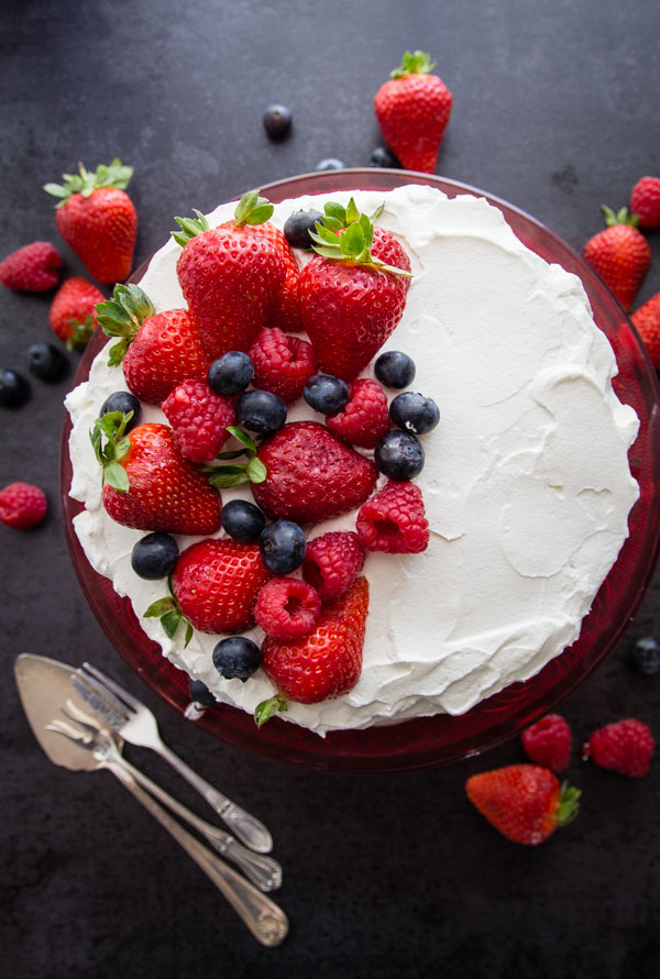 Strawberries and Cream Vertical Layer Cake, a simple fresh fruit and cream dessert recipe, the perfect 4th of July dessert.