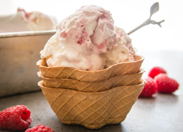 3 scoops of raspberry ripple ice cream in 3 cone cups