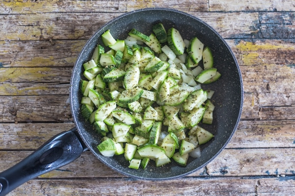 chopped zucchini, onion & garlic in a pan