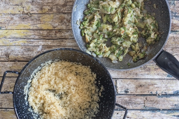 cooked zucchini & rice in pans