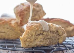 pouring maple glaze on brown sugar cinnamon scones