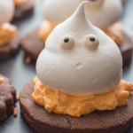 upclose photo of a meringue ghost chocolate sugar cookie