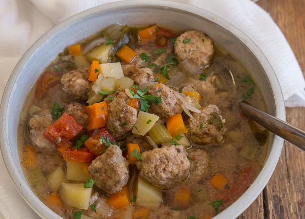 Italian meatballs soup in a bowl.