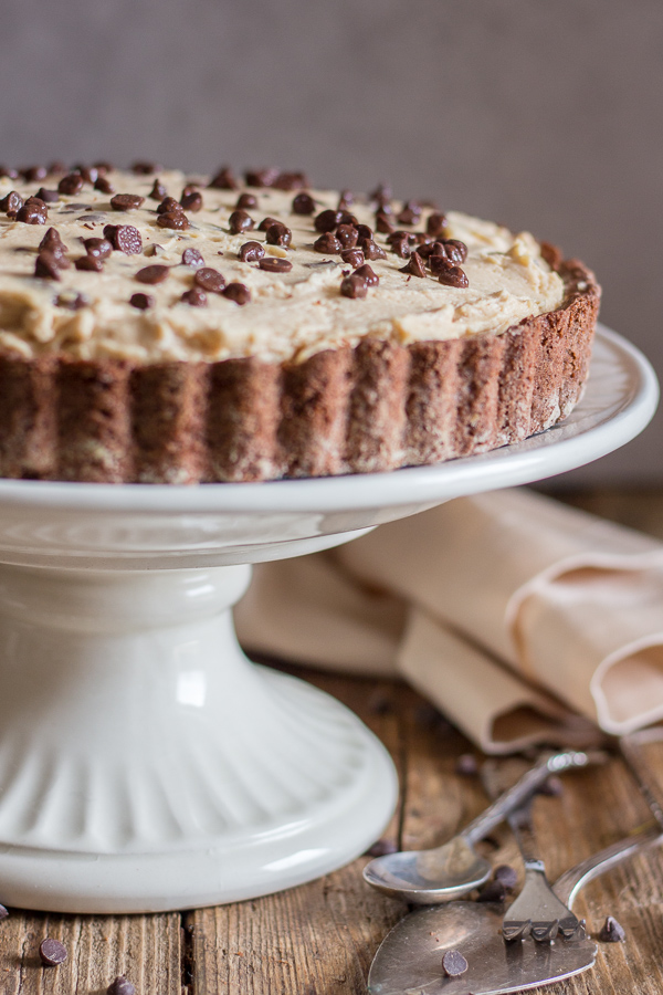 chocolate chip peanut butter pie on a white cake stand