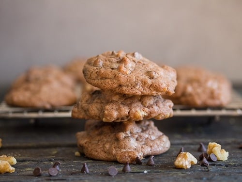 3 chocolate chip walnut cookies stacked