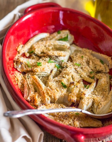 baked fennel in a red dish