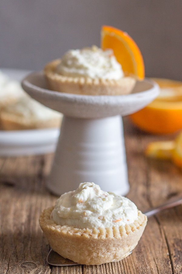 orange cheesecake tarts on a plate