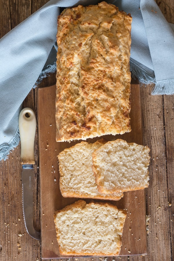 beer bread with three slices on a board