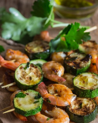grilled shrimp skewers on a wooden board