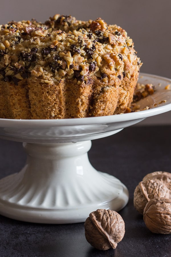 nut & coffee cake on a white cake stand