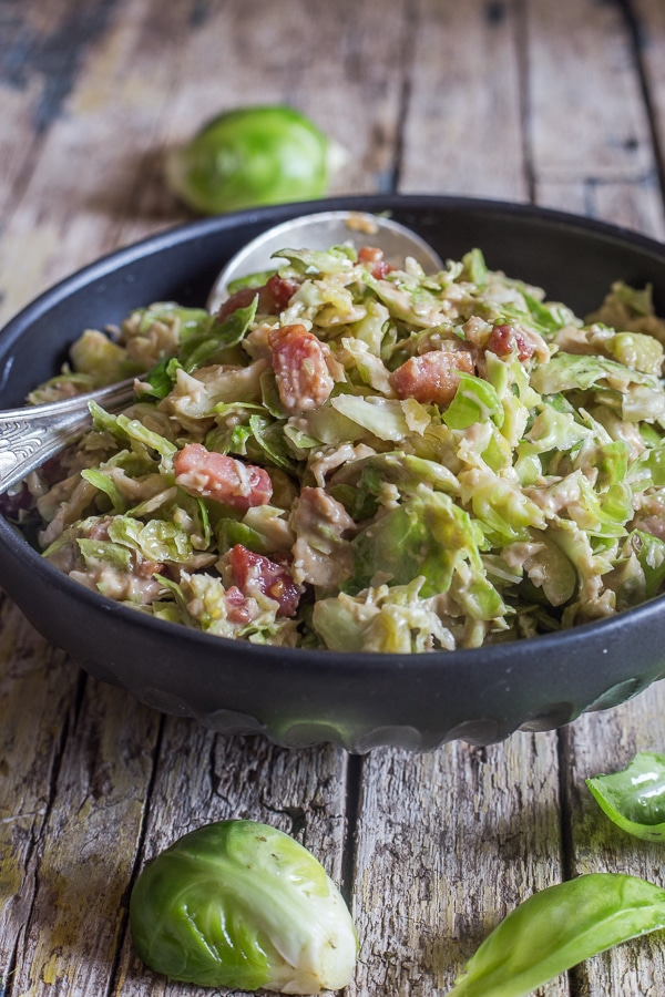 brussel sprout salad in a black bowl