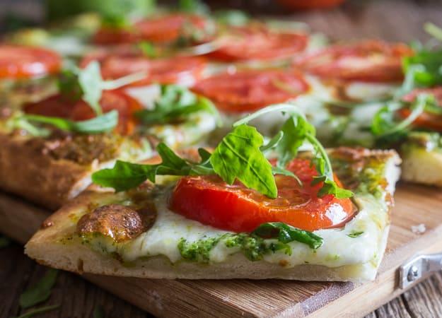 a slice of pesto pizza