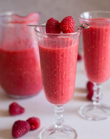raspberry slushie in 2 glasses and a jug