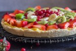 fruit pizza recipe up close on a black wire rack