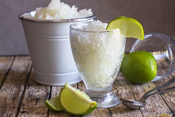 lime granita in a white bucket and some in a glass