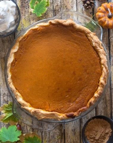 just baked pumpkin pie on a wooden board