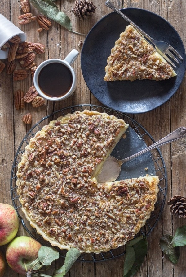 apple crostata on a plate and a slice