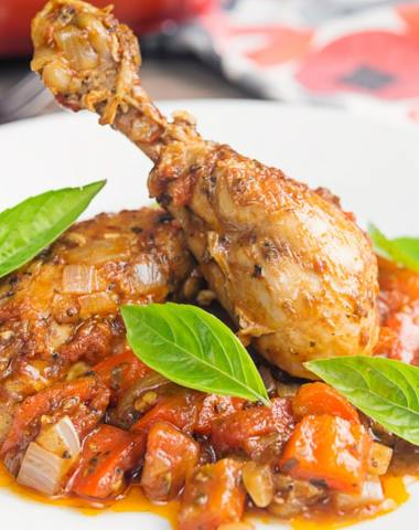 chicken cacciatore on a white plate