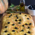 pumpkin focaccia bread on a wooden board