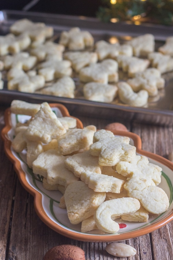 Italian almond cookies in a snowman dish and on a silver tray
