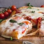 a slice cut of no knead pizza dough Pizza Margherita