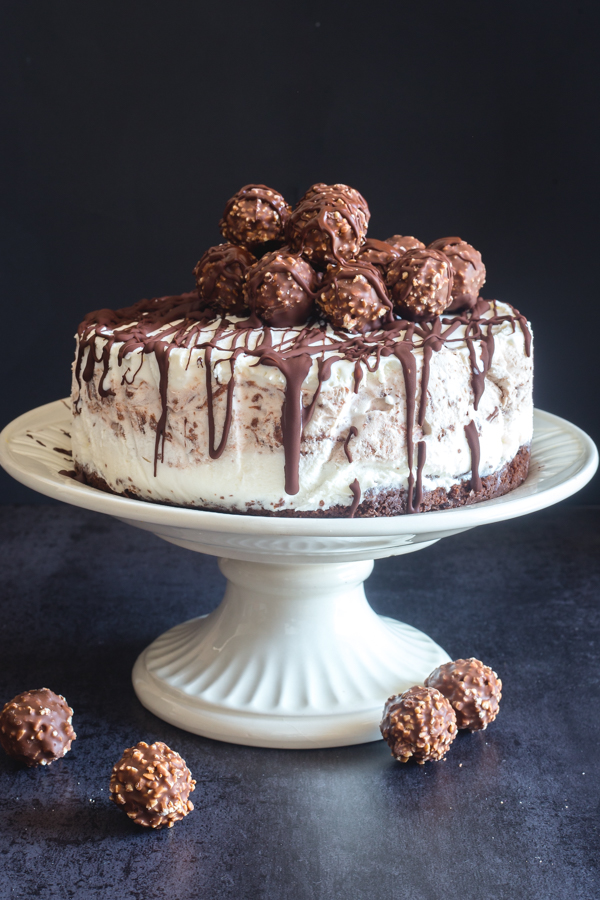 ice cream cake on a white plate stand