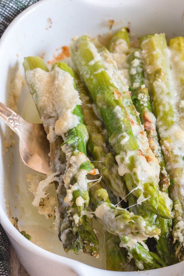 roasted asparagus in a white dish