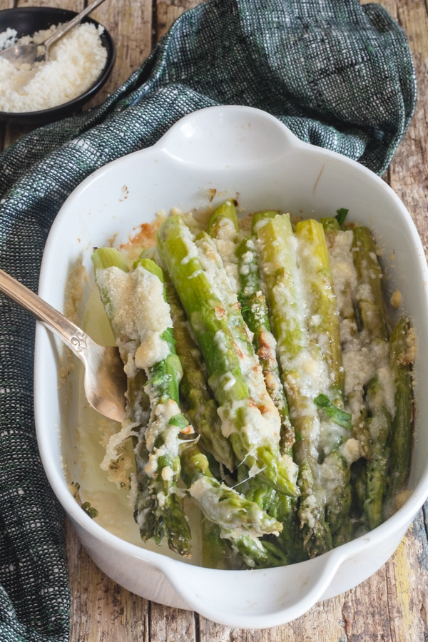 baked asparagus in a white dish
