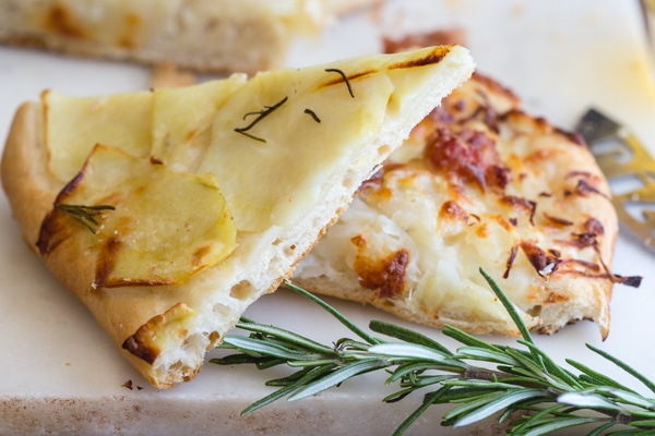 2 slices potato pizza simple and with sausage and cheese