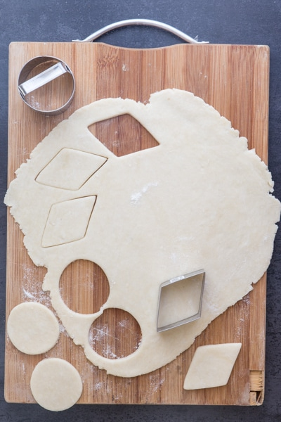 cutting out the flaky pie crust to make cookies